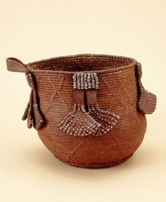 Basket, Ovahimba, Namibia. pigment, leather, vegetal fibre, iron alloy, ostrich shell beads, fat, ca. 1990