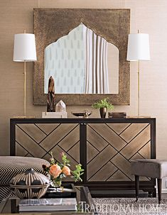 Warm beige grass-cloth walls set the stage for a clean-lined custom chest and Moroccan-style mirror. - Photo: John Bessler / Design: Young Huh