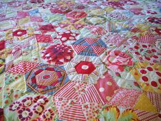 ~ candied hexagons by lizzie_broderie, via Flickr  Looks like Westminster Fabric Kaffe Fasset et al. Neat idea to feature large scale prints