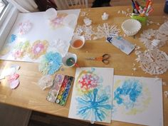 Painting water colors on coffee filter snowflakes
