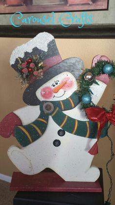 Cute Snowman Craft.  Made of wood. Holding wreath with lights. By Carousel Crafts