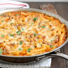 This Skillet Baked Ziti with Sausage recipe by Tracey's Culinary Adventures is the perfect comfort food for cold winter evenings!
