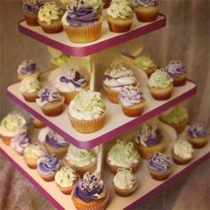 Small Cupcake Tower : Mixed with mini and regular size gourmet wedding cupcakes on a small cupcake tower from Sweet Sanctions.