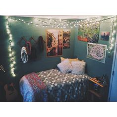 Dorm room decorations / Christmas lights / Dorm art / Urban outfitters bed spread /College life.