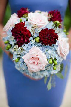 Roses, blue hydrangeas, burgundy dahlias, seeded eucalyptus, green hypericum berries