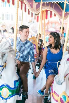 Carousel engagement photos at Magic Kingdom. Whimsical engagement shoot on a merry-go-round