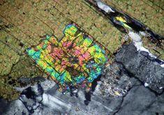 Monazite (XPL): note the extreme birefringence and diamond shape