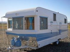 Restoration ideas for repainting vintage trailer. I like the chrome plate.