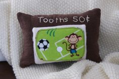 Tooth fairy pillow soccer monkey. Tooth Pillow, Tooth Fairy Pillow, Monkey, Teeth, Soccer, Throw Pillows, Unique Jewelry, Handmade Gifts, Kids