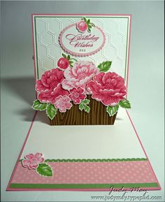 Flower box pop up card with simple box mechanism.