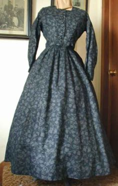 1800-1850 working dress Day or camp dress commonly worn for work and everyday life. The bodice is slightly fitted with front closings. The separate skirt is gathered on waistband . The skirt will accommodate several petticoats or a small hoop.