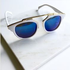 "NWT || So Real Meg Mirrored Cat Eye Sunglasses So cute, so fun. Get the So Real look without the price. White Matte frames with blue mirrored lenses and gold metal accents and brow bar. 100% UV protection. 5.8"" W x 2.1"" H. Available 4 other colors. Price is firm unless bundled. Bundle 4 or more and save 20%. Accessories Sunglasses"