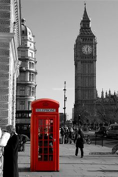 This is not a fake photo but real RED phone box that I have used and love that it is still standing. Can't get better than that..