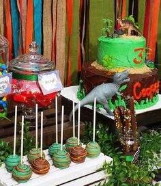 See more party planning ideas at CatchMyPar. Birthday Party Centerpieces, Carnival Birthday Parties, Dinosaur Birthday Party, 1st Boy Birthday, Birthday Party Themes, Birthday Ideas, Birthday Cake, Dinosaur Cake Pops, Party Cakes