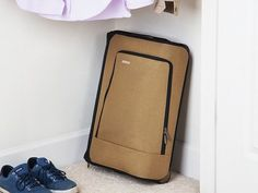 """A 360º handle that's easy on wrists, a fold-down-to-4"""" design to fit under the bed, and a USB charger. This suitcase, discovered by The Grommet, has everything."""