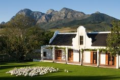 Babylonstoren, Franschhoek. #Babylonstoren is set in the heart of the beautiful Franschhoek Valley. The white gable, thatched roof and wide verandah or 'stoep' are typical of the Cape Dutch vernacular. #Africa #Design #Cape