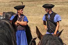 Traditional Herdsmen of Hungary take a break from rounding up livestock at Hortobagy National Park