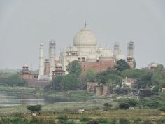 Taj Mahal as seen from the Red Fort, Agra, India Indian Architecture, G Adventures, Agra, National Geographic, Taj Mahal, Journey, Photo And Video, Building, Red