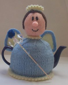 The Tea Fairy tea cosy from the TeaCosyFolk range of tea cosies has bags of character. You can buy the Tea Fairy tea cosy as a finished hand crafted tea cosy , or as a Tea Fairy tea cosy knitting pattern to make your own tea cosy with character Tea Cosy Knitting Pattern, Tea Cosy Pattern, Free Knitting, Knitting Patterns, Knitted Tea Cosies, Teapot Cover, Dragon Tea, Teapots Unique, Buy Tea