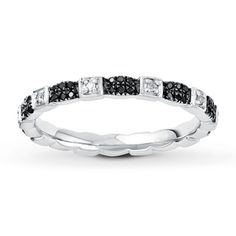 This lovely stackable ring has alternating round white diamonds and Jared Vivid® black diamonds on a 2.25mm sterling silver band. Black diamonds are treated to permanently create the intense black color. Diamond Total Carat Weight may range from .23 - .28 carats.