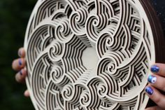 My wife and I have a long history of working with printmaking, ceramics, jewelry, and design. We started Thirty Circles in 2014 as our first collaboration. What started as laser cut jewelry grew into a larger project of laser cut art that we named Inner Space.