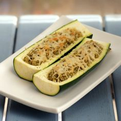 These zucchinis, stuffed with pesto quinoa and topped with parmesan cheese, make the perfect side dish - and will make you love your veggies Low Sugar Recipes, Wheat Free Recipes, No Sugar Foods, High Protein Recipes, Gluten Free Recipes, Vegetarian Recipes, Acid Reflux Recipes, How To Cook Quinoa, Cooked Quinoa