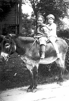 Girls riding on a donkey, Thirty-first Avenue South, Minneapolis. Subject: Harris, Dorisella Frances. Courtesy: © Minnesota Historical Society, St. Paul, MN (USA).