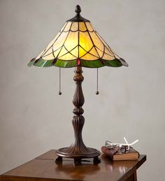 Marion Tiffany Stained Glass Table Lamp   Our Marion Tiffany Stained Glass Table Lamp complements any style decor. Comprised of 172 glass pieces and accented with 12 jewels, it gives off a soft amber glow when lit.