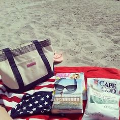 sunglasses, potato chips, books, all set for a day at the beach!