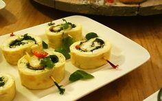 Omeletrolletjes met mozzarella, pesto en rucola