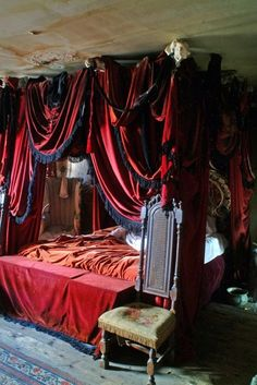 red canopy bed with black fringe, old room