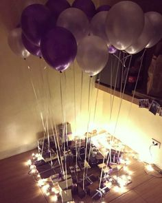 Had a birthday surprise for my boyfriend on his 24th birthday. Wrapped 24 gifts in silver and purple (his fave color) boxes then tied them to silver and purple helium balloons.