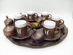 This set, bear the traces of lasting hand workmanship of Ottoman Empire. High quality metal parts. 100% Made in Turkey   1 x Sugar bowl 6 x Coffee Cup Holders 6 x White Ceramic inner Cups 6 x Saucers 6 x Top covers 1 x 35 cm Tray (13.77 inches)  Weight : 2.5 kg (5 lbs)  We give the best and the most advantageous price guarantee because of being manufacturer of this production. We have realized that many local vendors who buy this product from us, are trying to sell this production online…