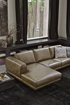An urban style leather sofa with comfortable, roomy cushions. Leather Corner Sofa, Leather Sofas, Living Room Sofa Design, Bedroom Furniture Design, Metal Sofa, Strong Personality, Laser Cut Metal, How To Finish A Quilt, Metal Bar