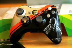 A Xbox 360 controller I painted my boyfriend for his birthday Call of Duty Black Ops 2 Custom Controller Xbox 360, Control Xbox, Call Of Duty Cakes, Consoles, Advanced Warfare, Xbox Console, Xbox Controller, Black Ops 3, Zombie Party