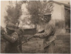 Liberated Jewish Concentration Camp Prisoner holding Nazi Soldier at Gunpoint - After all he'd been put through, he still didn't shoot when the chance arises.