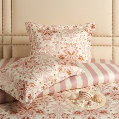 Create a luxe retreat in your master suite or guest room with this lovely cotton bedding set, showcasing a complementing stripe and floral motif.