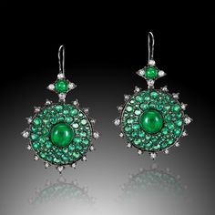Nam Cho earrings in 18k gold, set with emeralds, diamonds and emerald cabochons.