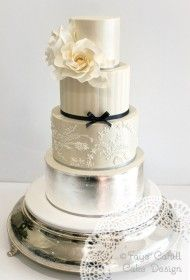 Custom Arcade. With lace tier based on brides gown.