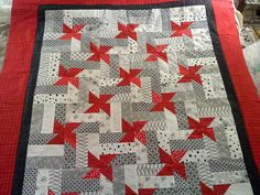 red, black and white pinwheel - wouldbe pretty in red, white and blue for quilts of valor