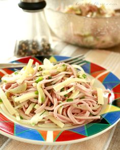 Wurstsalat or literally Sausage Salad is basically a type of sausage cut into julliene (long, thin) strips and then seasoned with vinegar, oil and pickles.| www.foxyfolksy.com
