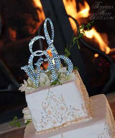 Traditional monogram cake topper with Swarovski crystals. Love it. Think I might like the two smaller initials in a different color from the large initial.