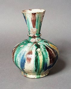 Ewer Egypt Ewer, 10th century Ceramic; Vessel, Earthenware, white engobe, underglaze painted, 9 1/2 x 4 in. (24.4 x 10.2 cm) Gift of William Lillys in Memory of Dr. Edward LB Terrace (M.83.251.1) Art of the Middle East: Islamic Department.