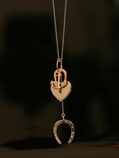 Philip Crangi 14KT Rose Gold and Steel Luck Hope Love Pendant with Horseshoe, Heart and Anchor Charms. Available at London Jewelers!