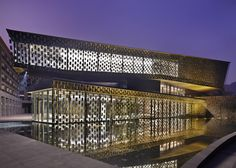 This museum in Xinjin, China, by Japanese architects Kengo Kuma and Associates appears to be screened by rows of floating tiles.
