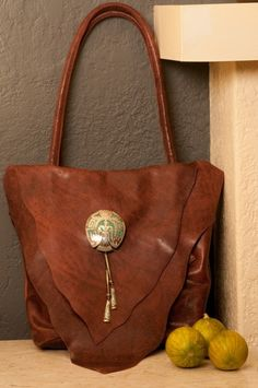 New Mexico artist Ifania has handcrafted this ifania ® Bolo Trading Company ® Handbag inspired by the rich cultures and lands of New Mexico, luxurious leather inside and out coupled with vintage bolo.  Artisan made in the USA.  www.ifaniadesigns.com www.bolotradingcompany.com