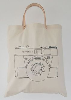 Totebag canvas cotton with print on 1 side and natural leather handles