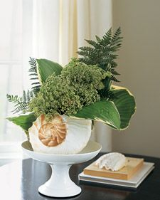 Make waves with an arrangement set in a  seashell. The trick is to fit a piece of floral foam inside the shell.