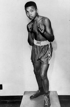 FILE - In this 1954 file photo, boxer Cassius Clay is shown. Long before his dazzling footwork and punching prowess made him a three-time world heavyweight boxing champion known as Muhammad Ali, a young Cassius Clay honed his skills by sparring with neighborhood friends and running alongside the bus on the way to school. Ali turns 70 on Jan. 17, 2012. (AP Photo/File) Photo: Associated Press