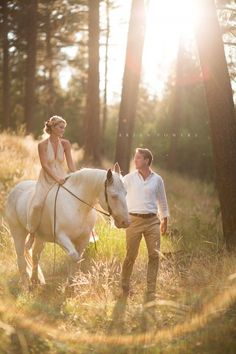 bride and groom with a horse photograph by Brian Powers